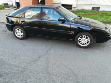 Mazda 323F, 1994 г.